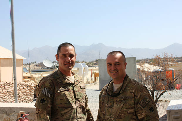 Warrant Officer 2 Todd Warrington, left, and Maj. Casey Reed are part of the Oklahoma Army National Guard's 45th Infantry Brigade Combat Team in Afghanistan. PHOTO PROVIDED