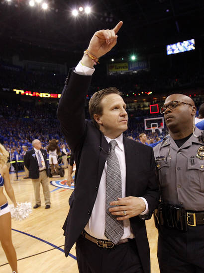 Oklahoma CIty coach Scott Brooks waves to the crowd after Game 5 in the second round of the NBA playoffs between the Oklahoma City Thunder and the L.A. Lakers at Chesapeake Energy Arena in Oklahoma City, Monday, May 21, 2012. Oklahoma City won 106-90. Photo by Bryan Terry, The Oklahoman