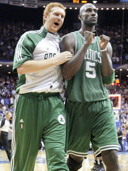Kevin Garnett, right, Brian Scalabrine and the Boston Celtics lead the Orlando Magic 2-0 in the Eastern Conference Finals. AP PHOTO