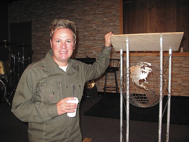 The Rev. Kurtis Ivey stands near the pulpit area at Light Your World Church in Okarche where he is pastor. <strong>CARLA HINTON - CARLA HINTON</strong>