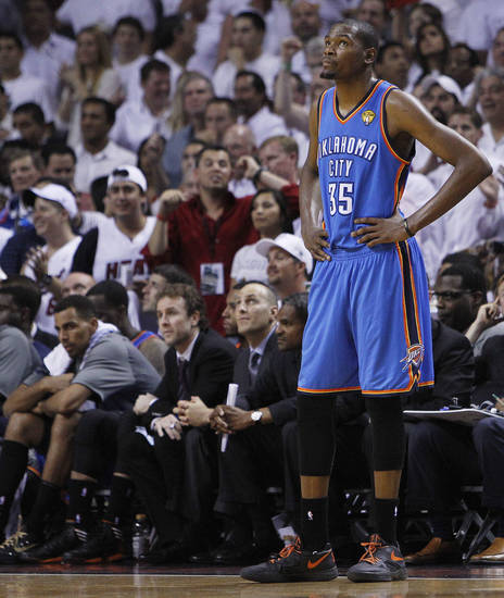 Oklahoma City Thunder small forward Kevin Durant (35) looks at the scoreboard during the second half at  Game 5 of the NBA finals basketball series against the Miami Heat, Thursday, June 21, 2012, in Miami. (AP Photo/Lynne Sladky) ORG XMIT: NBA155