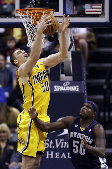Indiana Pacers' Tyler Hansbrough (50) grabs a rebound against Memphis Grizzlies' Zach Randolph (50) during the first half of an NBA basketball game, Monday, Dec. 31, 2012, in Indianapolis. (AP Photo/Darron Cummings)