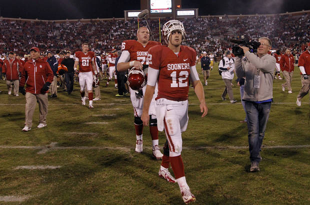 OU's Landry Jones (12) walks off the field after the 30-13 loss to Notre Dame during the college football game between the University of Oklahoma Sooners (OU) and the Notre Dame Fighting Irish at the Gaylord Family-Oklahoma Memorial Stadium on Saturday, Oct. 27, 2012, in Norman, Okla. Photo by Chris Landsberger, The Oklahoman