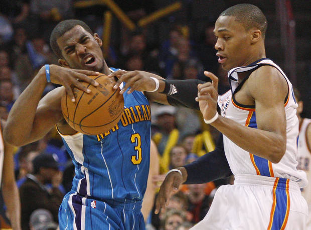 Oklahoma City's Russell Westbrook (0) fouls New Orleans' Chris Paul (3) during the NBA basketball game between the Oklahoma City Thunder and the New Orleans Hornets, Wednesday, Feb. 2, 2011 at the Oklahoma City Arena. Photo by Bryan Terry, The Oklahoman  ORG XMIT: KOD