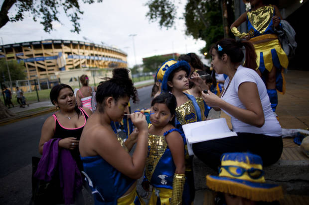 "Members of the murga ""Los amantes de La Boca"" prepare to participate in carnival celebrations in Buenos Aires, Argentina, Saturday, Feb. 2, 2013. Argentina�s carnival celebrations may not be as well-known as the ones in neighboring Uruguay and Brazil, but residents of the nation�s capital are equally passionate about their �murgas,� or traditional musical troupes. The murga ""Los amantes de La Boca,� or �The Lovers of The Boca� is among the largest, with about 400 members. It�s a reference to the hometown Boca Juniors, among the most popular soccer teams in Argentina and the world. (AP Photo/Natacha Pisarenko)"