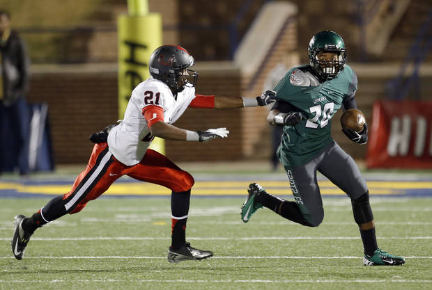 Edmond Santa Fe's Carmon Westbrook tries to get by Union's Kahlil Harper during the high school football game between Edmond Santa Fe and Union at Wantland Stadium in Edmond, Okla.,  Friday, Nov. 16, 2012. Photo by Sarah Phipps, The Oklahoman