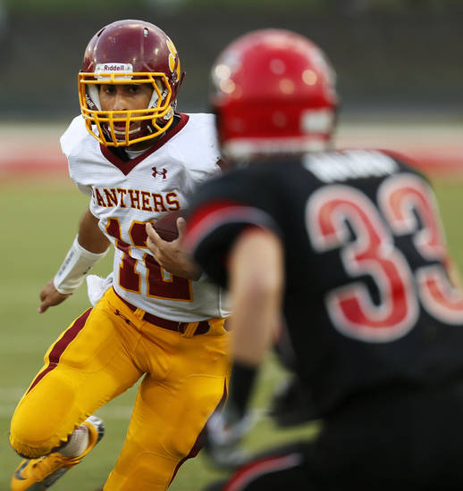 Putnam City North quarterback John Simon (12) keeps the ball during a high school football game between Mustang and Putnam City North in Mustang, Okla., Friday, Sept. 7, 2012. Photo by Nate Billings, The Oklahoman