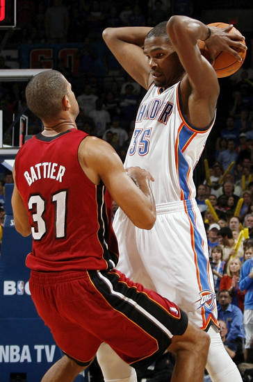 Oklahoma City's Kevin Durant (35) keeps the ball away from Miami's Shane Battier (31) during the NBA basketball game between the Miami Heat and the Oklahoma City Thunder at Chesapeake Energy Arena in Oklahoma City, Sunday, March 25, 2012. Oklahoma City won, 103-87. Photo by Nate Billings, The Oklahoman