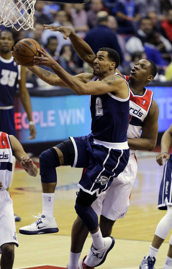 Oklahoma City Thunder guard Thabo Sefolosha, from Switzerland, shoots past Washington Wizards forward Kevin Seraphin, from France, in the second half of an NBA basketball game Monday, Jan. 7, 2013, in Washington. The Wizards won 101-99.(AP Photo/Alex Brandon) ORG XMIT: VZN115