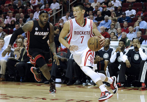 Houston Rockets' Jeremy Lin (7) drives ahead of Miami Heat's LeBron James (6) in the second half of an NBA basketball game Monday, Nov. 12, 2012, in Houston. The Heat won 113-110. (AP Photo/Pat Sullivan)