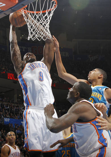 Oklahoma City Thunder's Serge Ibaka (9) gets a rebound over New Orleans Hornets' Anthony Davis (23) during the NBA basketball game between the Oklahoma CIty Thunder and the New Orleans Hornets at the Chesapeake Energy Arena on Wednesday, Dec. 12, 2012, in Oklahoma City, Okla.   Photo by Chris Landsberger, The Oklahoman