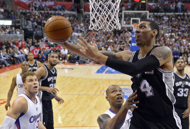 San Antonio Spurs shooting guard Danny Green, right, puts up a shot as Los Angeles Clippers forward Blake Griffin, lower left, and small forward Caron Butler, center defend during the second half of their NBA basketball game, Thursday, Feb. 21, 2013, in Los Angeles. (AP Photo/Mark J. Terrill)  ORG XMIT: LAS116