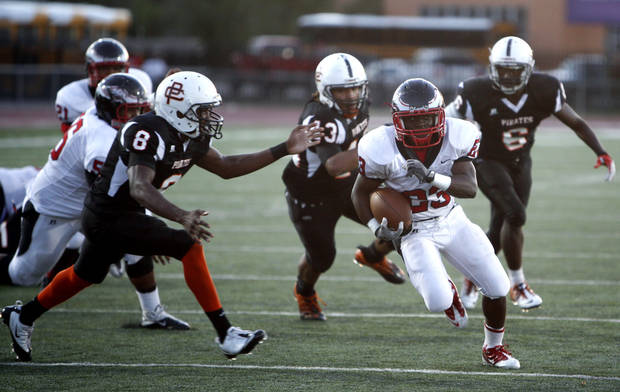 Del City's Anthony Mason tries to get by Putnam City's Anthony Hogg during the high school football game between Putnam City and Del City in Oklahoma City,  Thursday, Sept. 29, 2011. Photo by Sarah Phipps, The Oklahoman