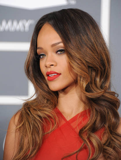 FILE - In a Sunday, Feb. 10, 2013 file photo, Rihanna arrives at the 55th annual Grammy Awards, in Los Angeles. Rihanna's representative said that the singer's show in Baltimore on Tuesday, March 12, 2013 would be postponed. Rihanna canceled her Sunday show in Boston because she was sick. The concert promoter said fans are instructed to retain their tickets pending rescheduling show date information. The next date on Rihanna's tour is Thursday in Philadelphia. (Photo by Jordan Strauss/Invision/AP) ORG XMIT: NY127
