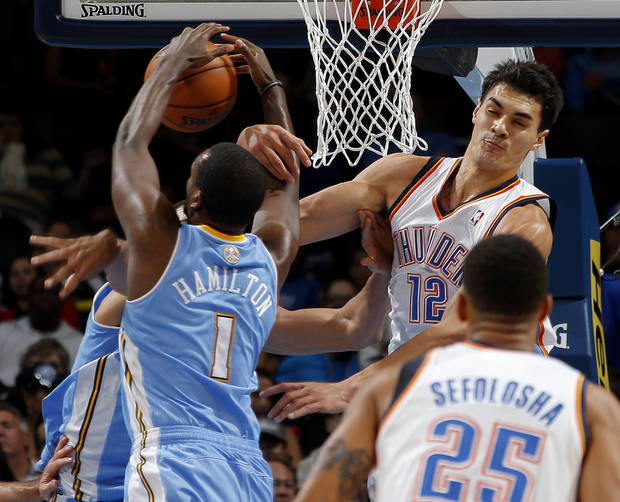 Oklahoma City 's Steven Adams (12) goes for the ball beside Denver's Jordan Hamilton (1) during an NBA preseason game between the Oklahoma City Thunder and the Denver Nuggets at Chesapeake Energy Arena on Tuesday, october 15, 2013. Tuesday, Oct. 15, 2013. Photo by Bryan Terry, The Oklahoman