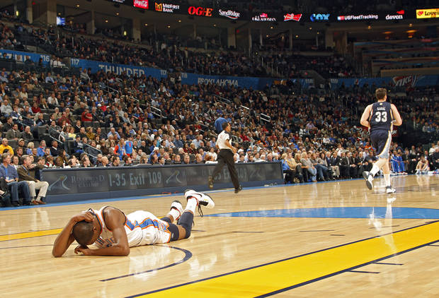 The Thunder&#039;s Kevin Durant lies on the court in pain after hitting his head during the NBA basketball game between the Oklahoma City Thunder and the Memphis Grizzlies at the Oklahoma City Arena on Tuesday, Feb. 8, 2011, Oklahoma City, Okla.  Photo by Chris Landsberger, The Oklahoman