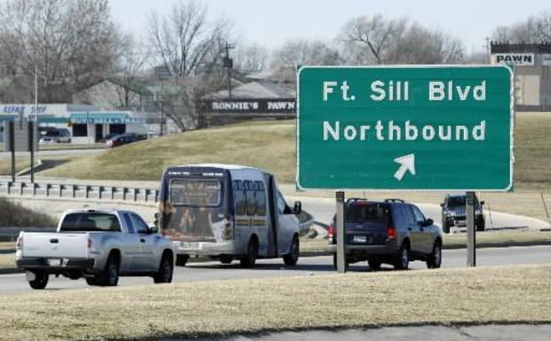 File photo - Traffic moves along Cache Road near the entrance to Ft. Sill Army base on Wednesday, Dec. 16, 2009, in Lawton, Okla. Photo by Steve Sisney