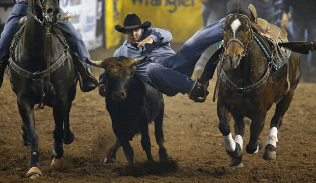 Kamry Dymmek of Kissimmee, Fla., competes in steer wrestling during the National Circuit Finals Rodeo at the State Fair Arena in Oklahoma City, Thursday, April 4, 2013. Photo by Bryan Terry, The Oklahoman