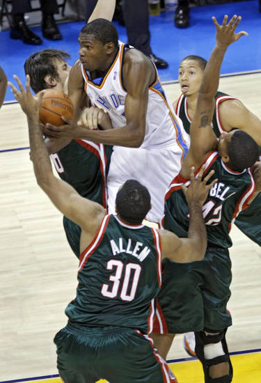 Kevin Durant of the Thunder drives through the Bucks defense during the second half of the opening night NBA basketball game between the Oklahoma City Thunder and the Milwaukee Bucks on Wednesday, Oct. 29, 2008, at the Ford Center in Oklahoma City, Okla.