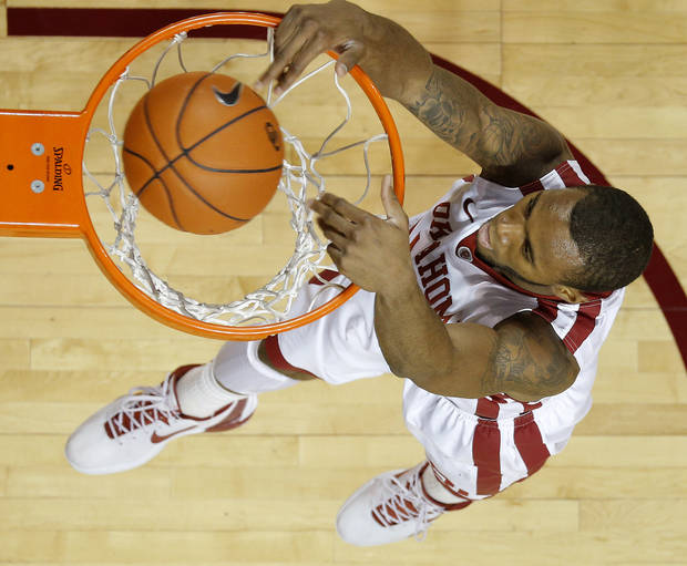 Oklahoma's Amath M'Baye (22) dunks during an NCAA college basketball game between the University of Oklahoma and Texas Tech University at Lloyd Noble Center in Norman, Okla., Wednesday, Jan. 16, 2013. Photo by Bryan Terry, The Oklahoman