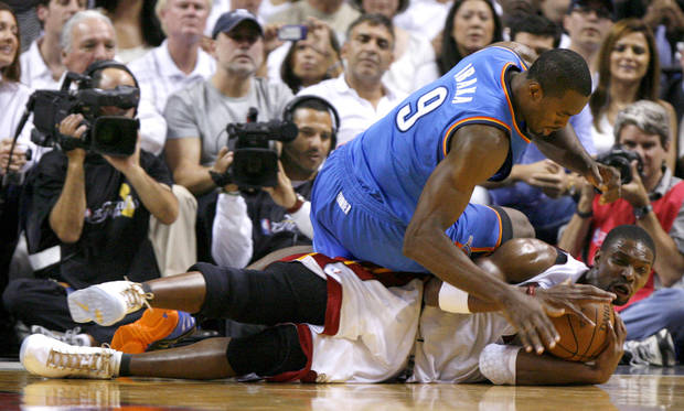 Miami's Chris Bosh (1) goes for the ball under Oklahoma City's Serge Ibaka (9) during Game 4 of the NBA Finals between the Oklahoma City Thunder and the Miami Heat at American Airlines Arena, Tuesday, June 19, 2012. Photo by Bryan Terry, The Oklahoman