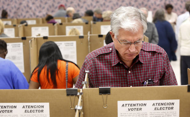 A man marks his ballot with other early voters inside the Oklahoma County Election Board on N. Lincoln Blvd,  Monday afternoon, Nov. 5, 2012.    Photo by Jim Beckel, The Oklahoman