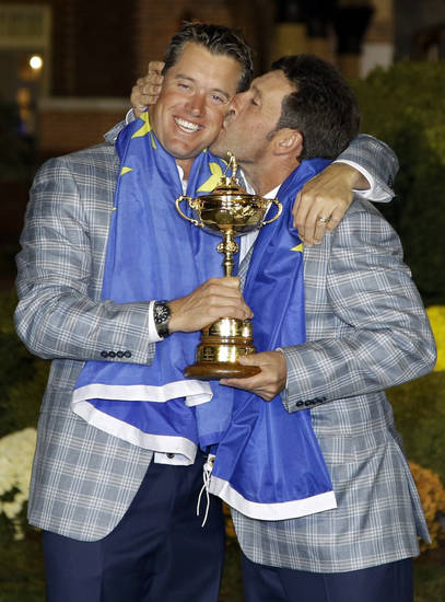 European team captain Jose Maria Olazabal kisses Lee Westwood after winning the Ryder Cup PGA golf tournament Sunday, Sept. 30, 2012, at the Medinah Country Club in Medinah, Ill. (AP Photo/David J. Phillip)  ORG XMIT: PGA262