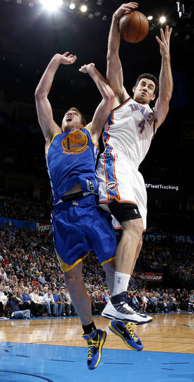 Oklahoma City's Nick Collison (4) grabs the ball beside Golden State's David Lee (10) during an NBA basketball game between the Oklahoma City Thunder and the Golden State Warriors at Chesapeake Energy Arena in Oklahoma City, Wednesday, Feb. 6, 2013. Photo by Bryan Terry, The Oklahoman