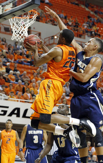 Oklahoma State's Markel Brown (22) shoots a lay up as UC Davis' Ryan Sypkens (25) defends during the men's college basketball game between Oklahoma State and UC Davis at  Gallagher-Iba Arena in Stillwater, Okla., Friday, Nov. 9, 2012. Photo by Sarah Phipps, The Oklahoman