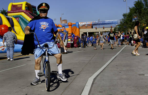 Captain Thunder rides a Schwinn Stingray in Thunder Alley before game 3 of the Western Conference Finals of the NBA basketball playoffs between the Dallas Mavericks and the Oklahoma City Thunder at the OKC Arena in downtown Oklahoma City, Saturday, May 21, 2011. Photo by Chris Landsberger, The Oklahoman