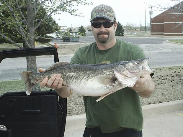 Ken Flowers of Oklahoma City caught this 9-pound, 12-ounce walleye Thursday at Lake Hefner at 10:30 p.m. near the water canal inlet.