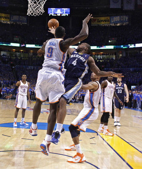Oklahoma City's Serge Ibaka (9) defends on Sam Young (4) of Memphis during game two of the Western Conference semifinals between the Memphis Grizzlies and the Oklahoma City Thunder in the NBA basketball playoffs at Oklahoma City Arena in Oklahoma City, Tuesday, May 3, 2011. Photo by Chris Landsberger, The Oklahoman