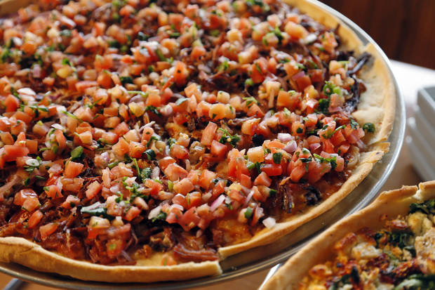 The Carnitas pizza at Pizza 23 in Oklahoma City is topped with pulled pork and pico de gallo. <strong>NATE BILLINGS - NATE BILLINGS</strong>