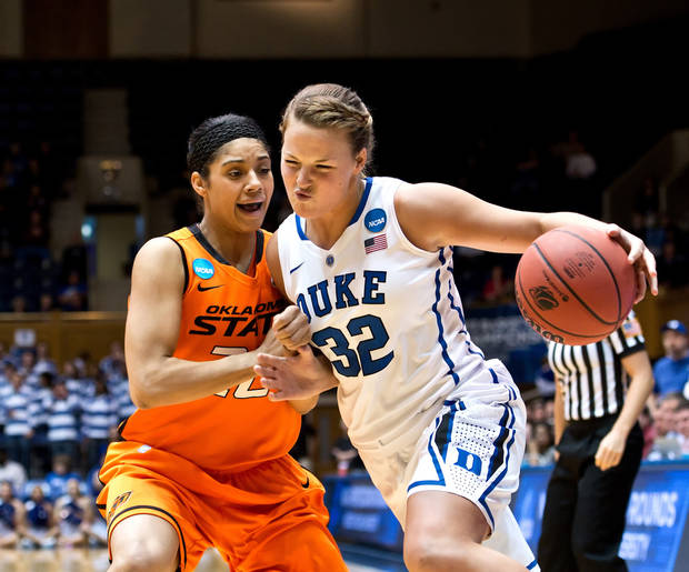 Duke's Tricia Liston (32) looks to move past Oklahoma State's Brittney Martin (22) during the first half in the women's NCAA Tournament at Cameron Indoor Stadium in Durham, North Carolina, Tuesday, March 26, 2013. (Greg Mintel/Raleigh News & Observer/MCT)