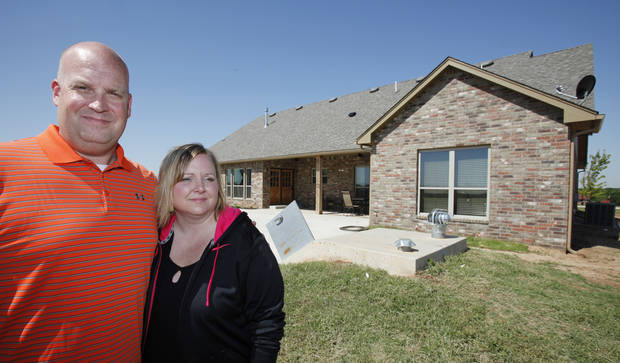 Chad and Becky Brown built back after the May 24, 2011 tornado, Wednesday, May 16, 2012. The storm shelter behind is where they rode out the tornado and is  the only  part of the original home left. Photo By David McDaniel/The Oklahoman
