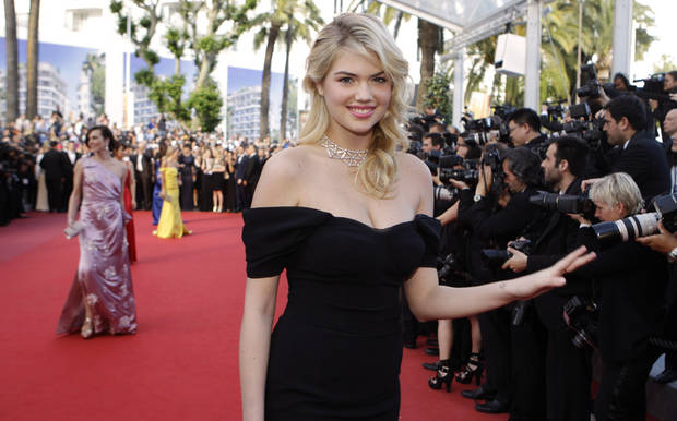 Models Kate Upton, right, and Milla Jovovich, back left, arrive for the screening of On the Road at the 65th international film festival, in Cannes, southern France, Wednesday, May 23, 2012. (AP Photo/Lionel Cironneau)