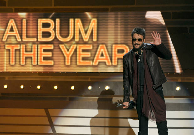 "Eric Church accepts the award for album of the year for ""Chief"" at the 48th Annual Academy of Country Music Awards at the MGM Grand Garden Arena in Las Vegas on Sunday, April 7, 2013. (Photo by Chris Pizzello/Invision/AP) ORG XMIT: NVPM259"