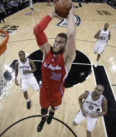 Los Angeles Clippers' Blake Griffin (32) soars to the basket during the first quarter of Game 1 of an NBA basketball Western Conference semifinal playoff series, Tuesday, May 15, 2012, in San Antonio. (AP Photo/Eric Gay)