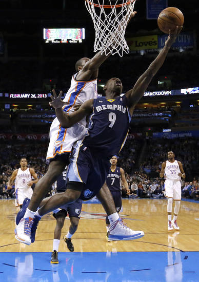 Oklahoma City's Serge Ibaka (9) defends as Memphis' Tony Allen (9) attempts a lay up during the NBA basketball game between the Oklahoma City Thunder and the Memphis Grizzlies at the Chesapeake Energy Arena in Oklahoma City,  Thursday, Jan. 31, 2013.Photo by Sarah Phipps, The Oklahoman