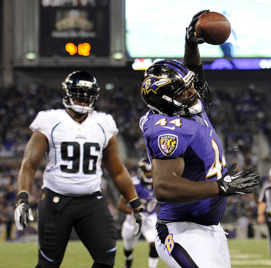 Baltimore Ravens running back Vonta Leach, right, celebrates in front of Jacksonville Jaguars defensive tackle Terrance Knighton after scoring a touchdown in the second half of an NFL preseason football game in Baltimore, Thursday, Aug. 23, 2012. (AP Photo/Nick Wass)