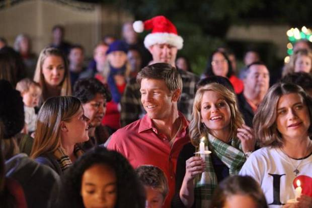 "Burgess Jenkins and Candace Cameron Bure, center, in ""The Heart of Christmas"" - GMC Photo"