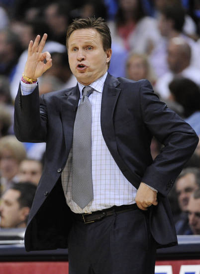 Oklahoma City Thunder head coach Scott Brooks signals to his team during the first half in game 4 of a first-round NBA basketball playoff series against the Denver Nuggets Monday, April 25, 2011, in Denver. (AP Photo/Jack Dempsey)