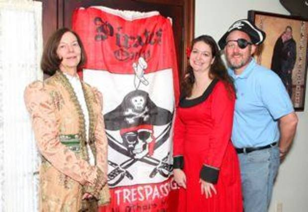 Mary Ellen and Samonia Meredith, Dennis Byford greet guests at their annual Pirates' Party in Oklahoma City. (Photo by David Faytinger.)