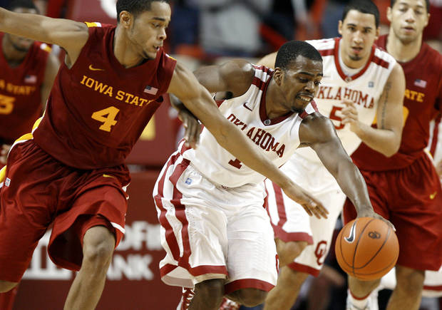 Oklahoma's Sam Grooms (1) tries to gain control of the ball beside Iowa State's Chris Allen (4) during an NCAA basketball game between the University of Oklahoma Sooners (OU) and the Iowa State Cyclones (ISU) at the Lloyd Noble Center in Norman, Saturday, Feb. 4, 2012. Photo by Bryan Terry, The Oklahoman