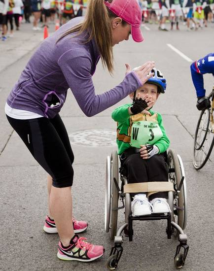 Just before the race began, mom Christi Gibson gave Ryder his final pep talk and a high five for good luck.  Ryder Gibson raced his third Redbud Classic on Sunday, April 6, 2014. Photo by KT King, The Oklahoman