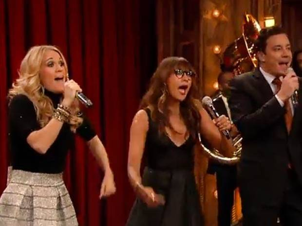 From left, Carrie Underwood, Rashida Jones and Jimmy Fallon parody popular songs holiday style.