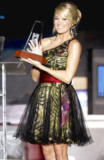 Carrie Underwood  smiles Thursday after her induction into  Oklahoma Music Hall of Fame in Muskogee.