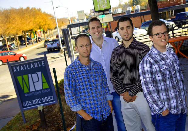 Ben Sellers, left, property owner, Josh Newberry, Orange Leaf owner, Justin Price, Pizza 23 owner and Ben Chamberlain, Orange Leaf owner, pose Tuesday for a photo in the 600 block of NW 23 in Oklahoma City.  Photo by Chris Landsberger, The Oklahoman