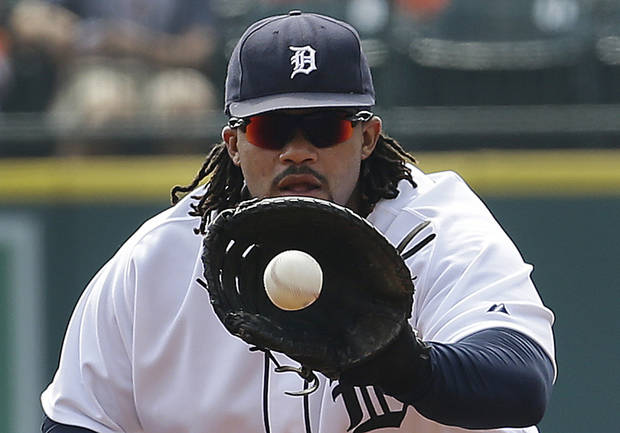 Detroit Tigers first baseman Prince Fielder fields a ground ball  hit by Seattle Mariners' Michael Saunders in the first inning of a baseball game in Detroit, Thursday, Sept. 19, 2013. Saunders was out on the play. (AP Photo/Paul Sancya)