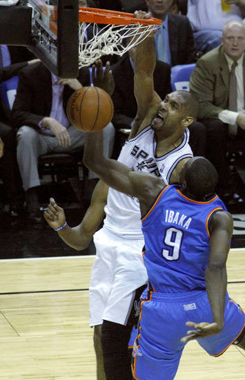 San Antonio's Tim Duncan (21) dunks the ball over Oklahoma City's Serge Ibaka (9) during Game 2 of the Western Conference Finals between the Oklahoma City Thunder and the San Antonio Spurs in the NBA playoffs at the AT&T Center in San Antonio, Texas, Tuesday, May 29, 2012. Oklahoma City lost 120-111. Photo by Bryan Terry, The Oklahoman